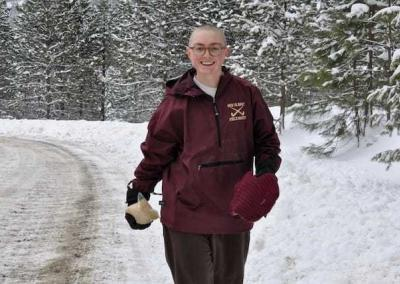 Em is on her way to feed cracked corn to the wild turkeys that are residing at the Abbey this winter.