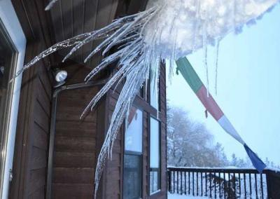 Huge icicles form along the lower roof and are close to pinch the windows!