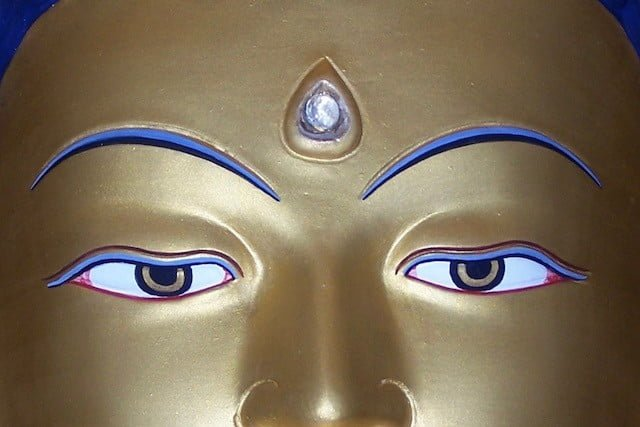 Day of Miracles, golden Buddha, close-up ofeyes