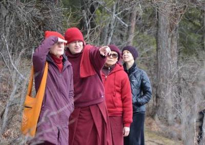 Two nuns and two laywomen in woods