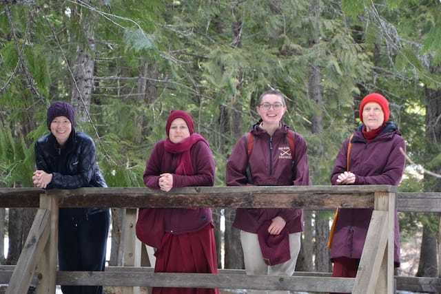 two nuns and two laywomen on bridge in company
