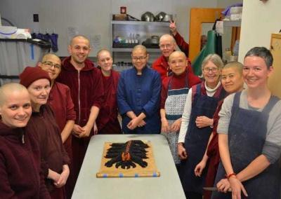monastics and laypeople with sesame seed scorpion