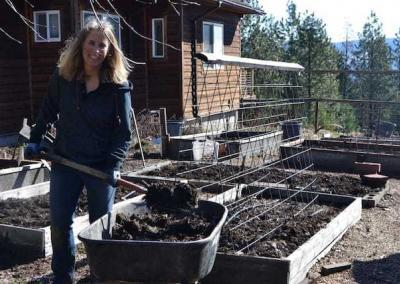 Evelynn gives great help in preparing the vegetable garden for a seeding.