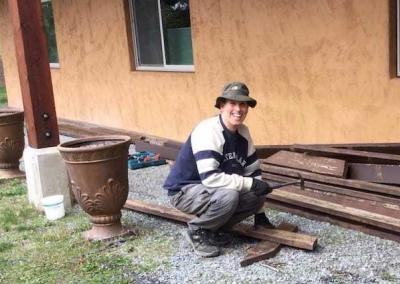 Andy from U.K. helps with replacing the old Ananda Hall deck.