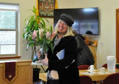 Our friend Julia Hayes makes a flower offering for the altar in the Meditation Hall.