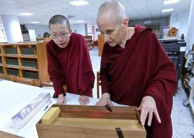 Vens. Chodron and Damcho are astonished to see hundreds-of-years-old Buddhist scriptures written on palm leaves.