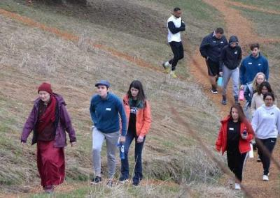 Ven. Samten leads students on a tour of the Abbey's property.
