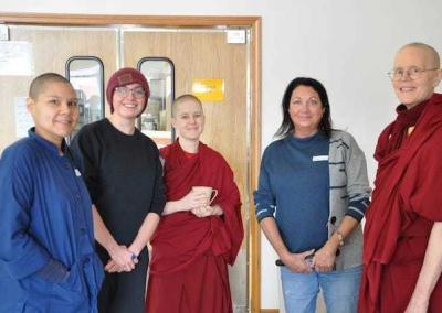 Christina, Em, Ven. Lamsel, Em's mother Bobbi, and Ven. Tarpa meet together before the Kathina ceremony begins.