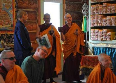 Ven. Nyima and Ven. Chonyi distribute small gifts to the volunteers who supported the retreat by providing food, recycling pick-up, prison outreach, and much more.