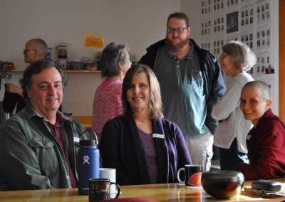 Dave, Janet, Ven. Jampa, and other guests enjoy tea and a chat.