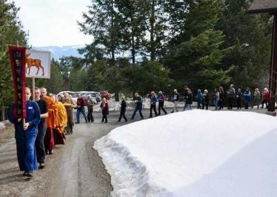 long line of laypeople and monastics