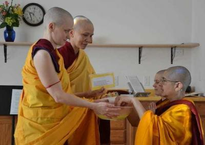 Ven. Jampa and Ven. Pende offer blessed water for monastics wash their hands—a sign of purity.