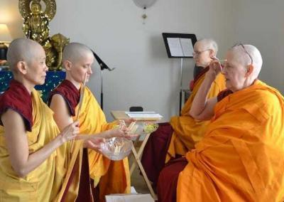 """Distributing and receiving counting sticks is also part of the ritual. Ven. Pende and Ven. Jampa """"receive the stick"""" from Ven. Jigme."""