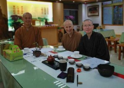 Ven. Chodron and Ven. Damcho have tea with Ven. Benyin, one of the main teachers at the ordination platform.