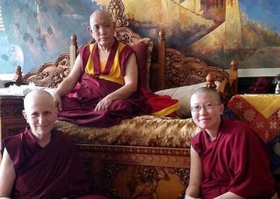 monk with two nuns