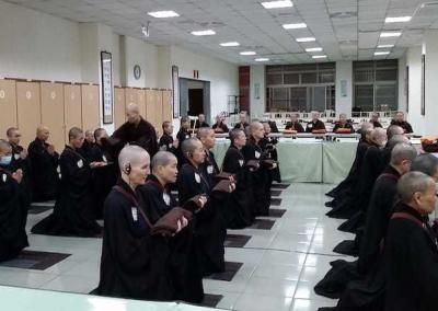 The bhikshunis-in-training—including Ven. Tsepal—learn how to hold their robes.