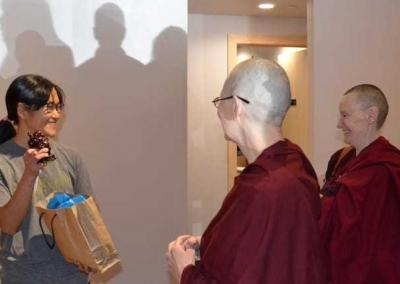 Kuni receives a small gift from the Abbey for her restaurant—a laughing Buddha.