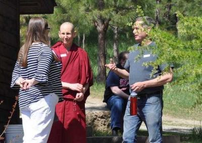 nun talking with lay people in sunshine