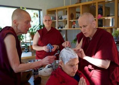 Ven. Sangye Khadro and Ven. Thubten Chodron start with the head shaving ceremony.