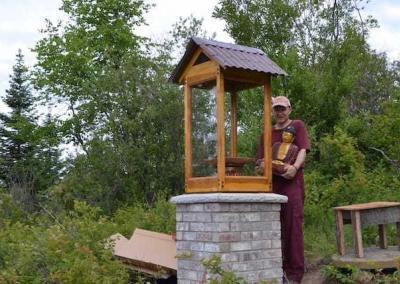 Ven. Losang rejoices at finishing the Buddha house for Sukhavati. Congratulations!