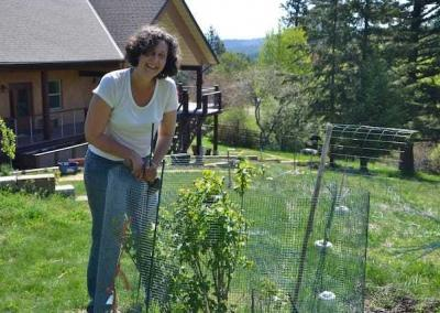 Patricia is a great help in setting up a protection system for young trees.
