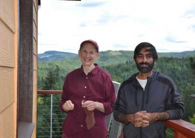 Ven. Tsepal and Kishan take a short photo break from window cleaning.