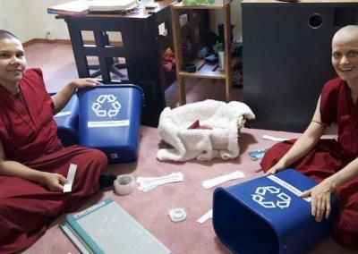 Vens. Kunga and Jampa prepare some recycling bins to support the Abbey's environmentally friendly way of living.