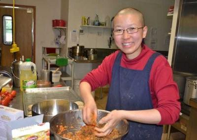 Ven. Damcho has a very good time in the kitchen.