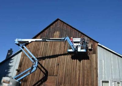 monastic and lay man in cherry picker