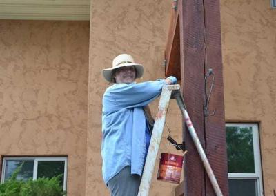 laywoman painting
