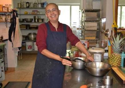 smiling monastic in kitchen