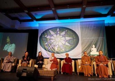 Ven. Chodron (in the Abbey cap) with her co-presenters.