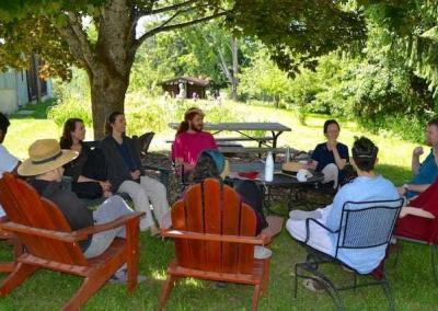 lay people sitting under tree