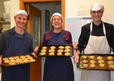 three laypeople with baked cookies