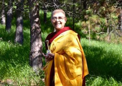 Ven. Nyima rings the bell to invite Ven. Chodron to teach.