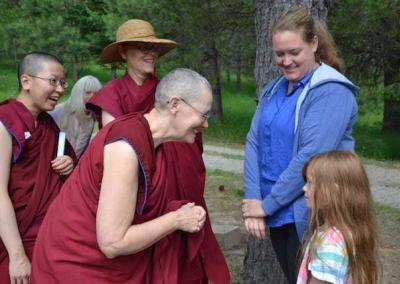 Ven. Chonyi attends to a young Sharing the Dharma Day visitor, whose presence delighted everyone.