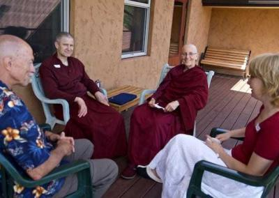 nuns and lay people on porch
