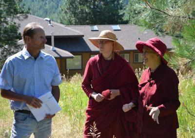 Tim, Ven. Tarpa, and Ven. Chodron discuss the Buddha Hall's location and how it will fit into the landscape.