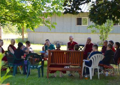 Ven. Chodron meets particpants for a group discussion in the garden.