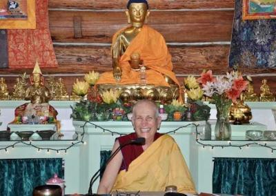 nun with Buddhist statue