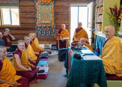 nuns and lay people in meditation hall
