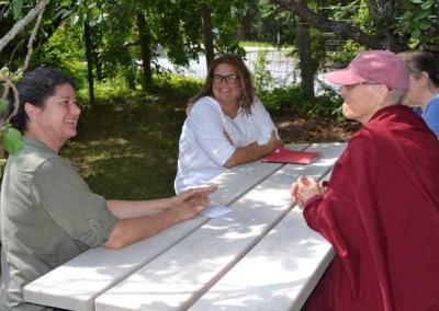 nun and lay women at picnic table