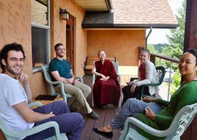 Ven. Damcho gathers a group of young participants to discuss the Dharma.