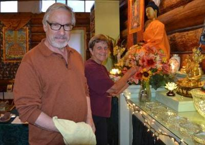 Richard and Kathy take care of the altar during the retreat.