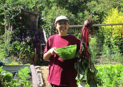 Ven. Nyima shows off her enormous beet harvest.
