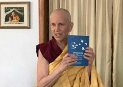 """Ven. Chodron presents her new book """"Unlocking Your Potential,"""" co-authored by prison Dharma writer Calvin Malone. Ven. Chodron presents her new book """"Unlocking Your Potential,"""" co-authored by prison Dharma writer Calvin Malone."""