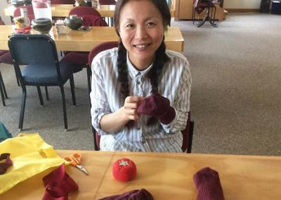 Rose shares her sewing skills during her visit from the UK.