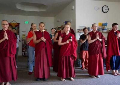 monastics and lay people standing in rows