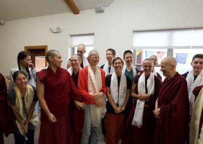 monastics and lay people wearing khatas
