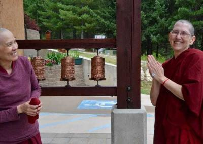 two nuns with prayer wheels